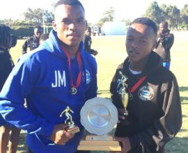SAG Coach Justin May and U16 player Aphiwe Baliti with their trophies